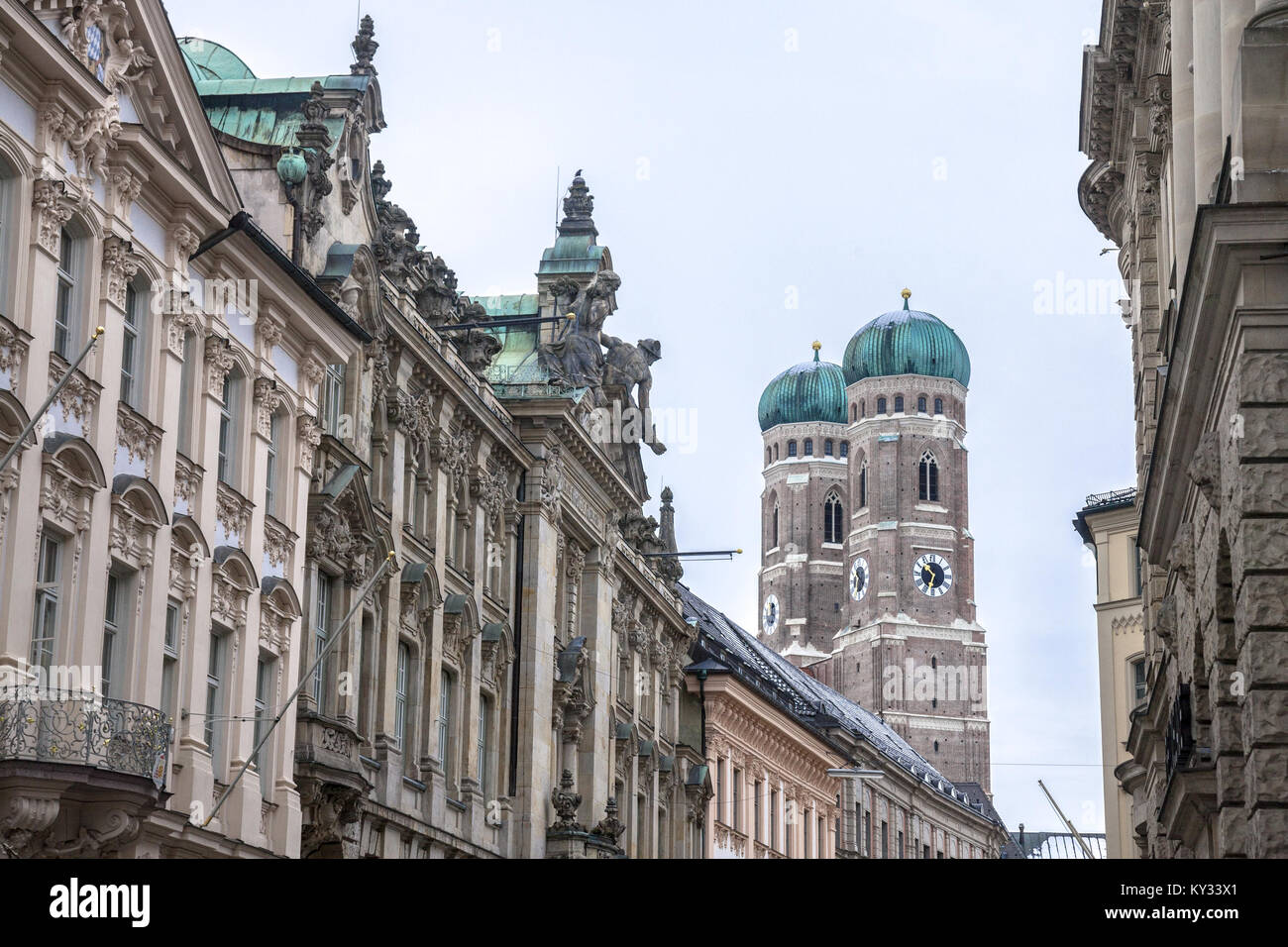 Munich Frauenkirche taken from a medieval nearby street in winter. The Frauenkirche is a church in the Bavarian - Stock Image