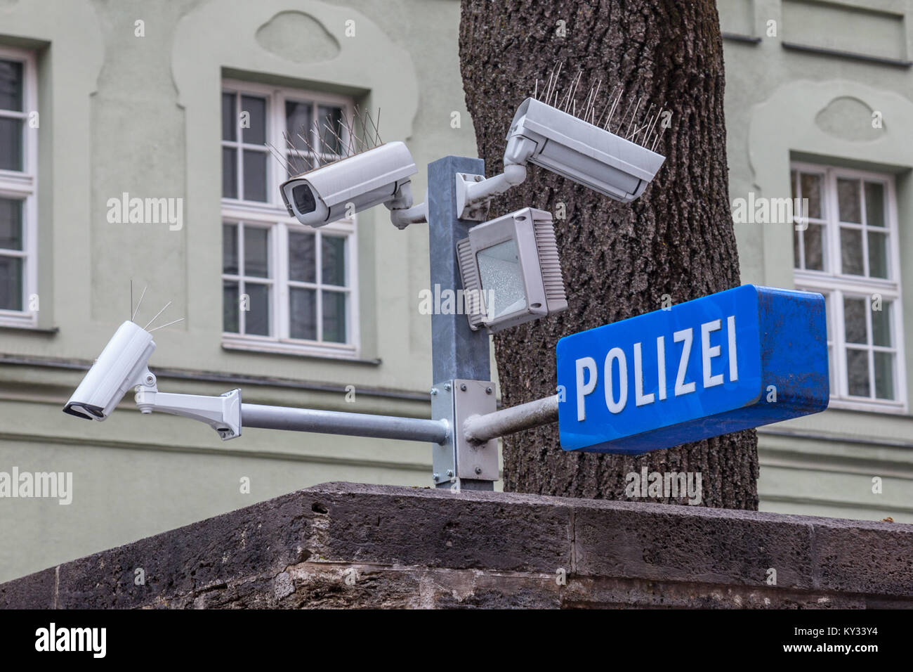 CCTV cameras on display next to a police station (with a police sign in German: Polizei) in the Bavarian city of - Stock Image