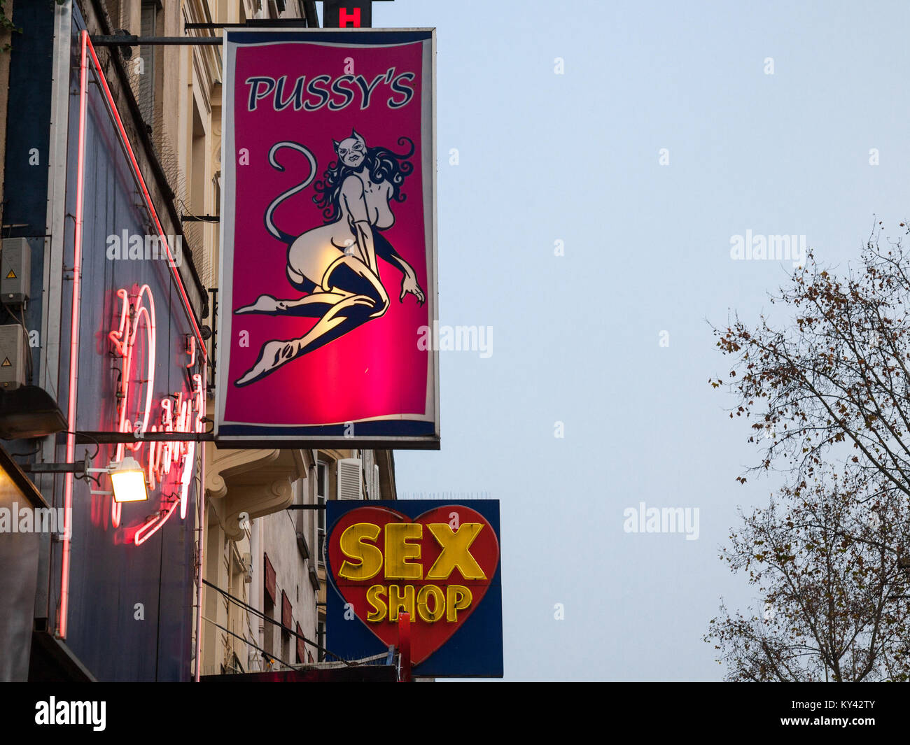 PARIS, FRANCE - DECEMBER 19, 2017: Sex Shop lights and front stores in the red light district of Paris, Pigalle. - Stock Image