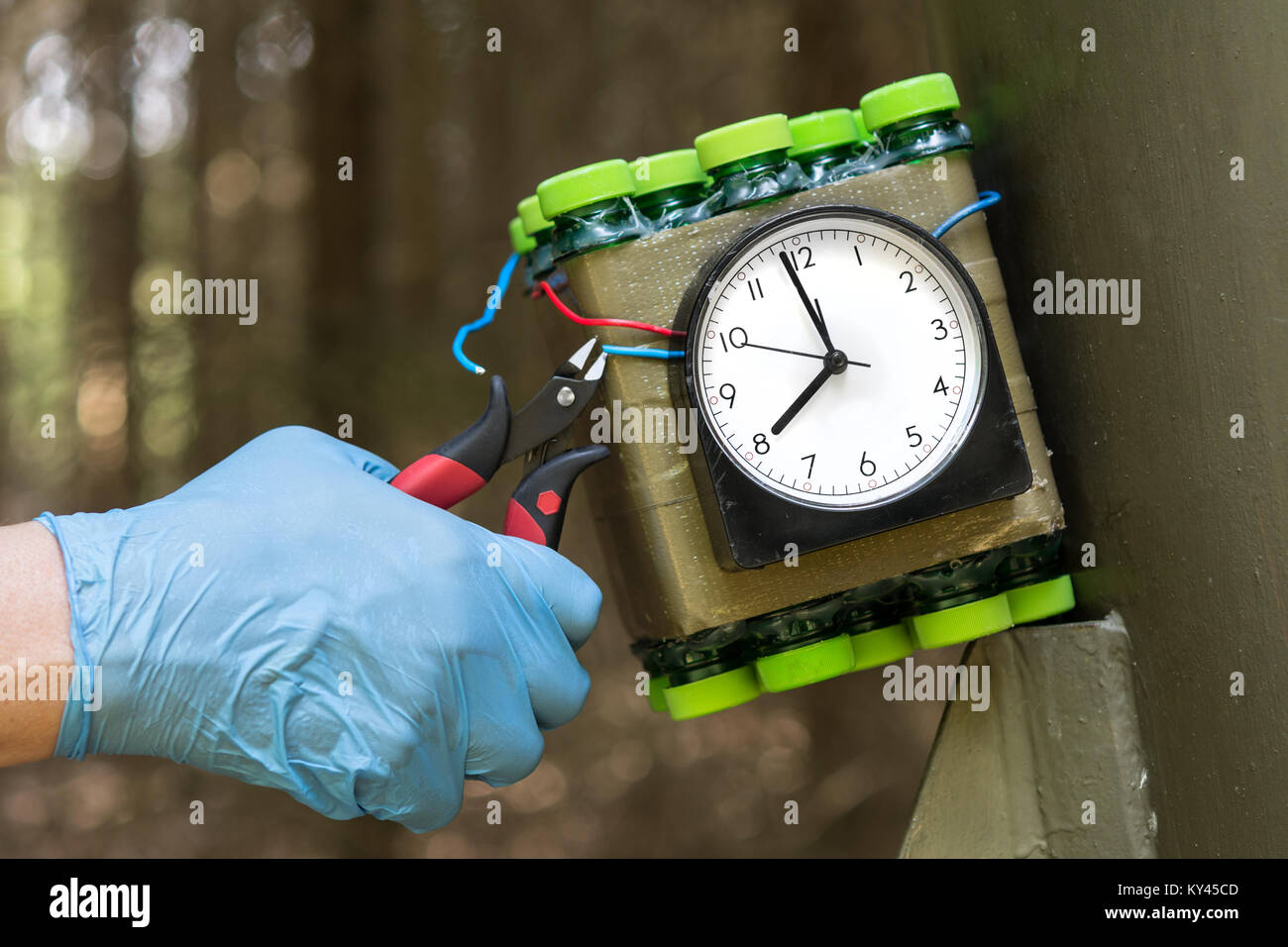 Deactivation of time bomb. Disposal of dangerous timebomb placed at a metal construction. - Stock Image