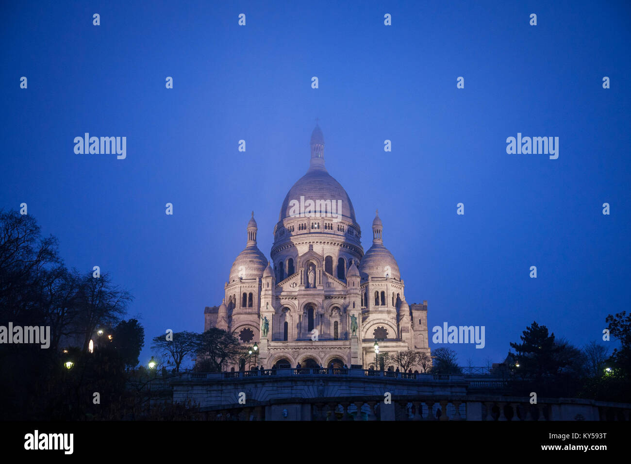 Sacre Coeur Basilica in Montmartre, Paris, illuminated during a winter night. The Basilica of the Sacred Heart of - Stock Image