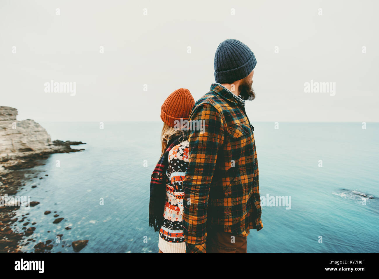 Couple lovers Man and Woman standing backs together Love and Travel happy emotions Lifestyle concept. Young family - Stock Image