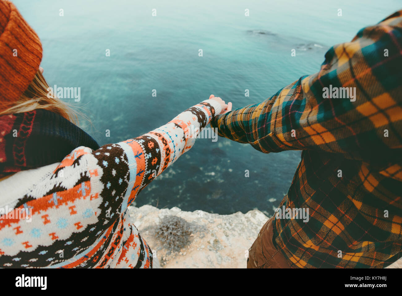 Couple in love holding hands Man and Woman Travel Lifestyle concept. Young family traveling romantic vacations autumn - Stock Image