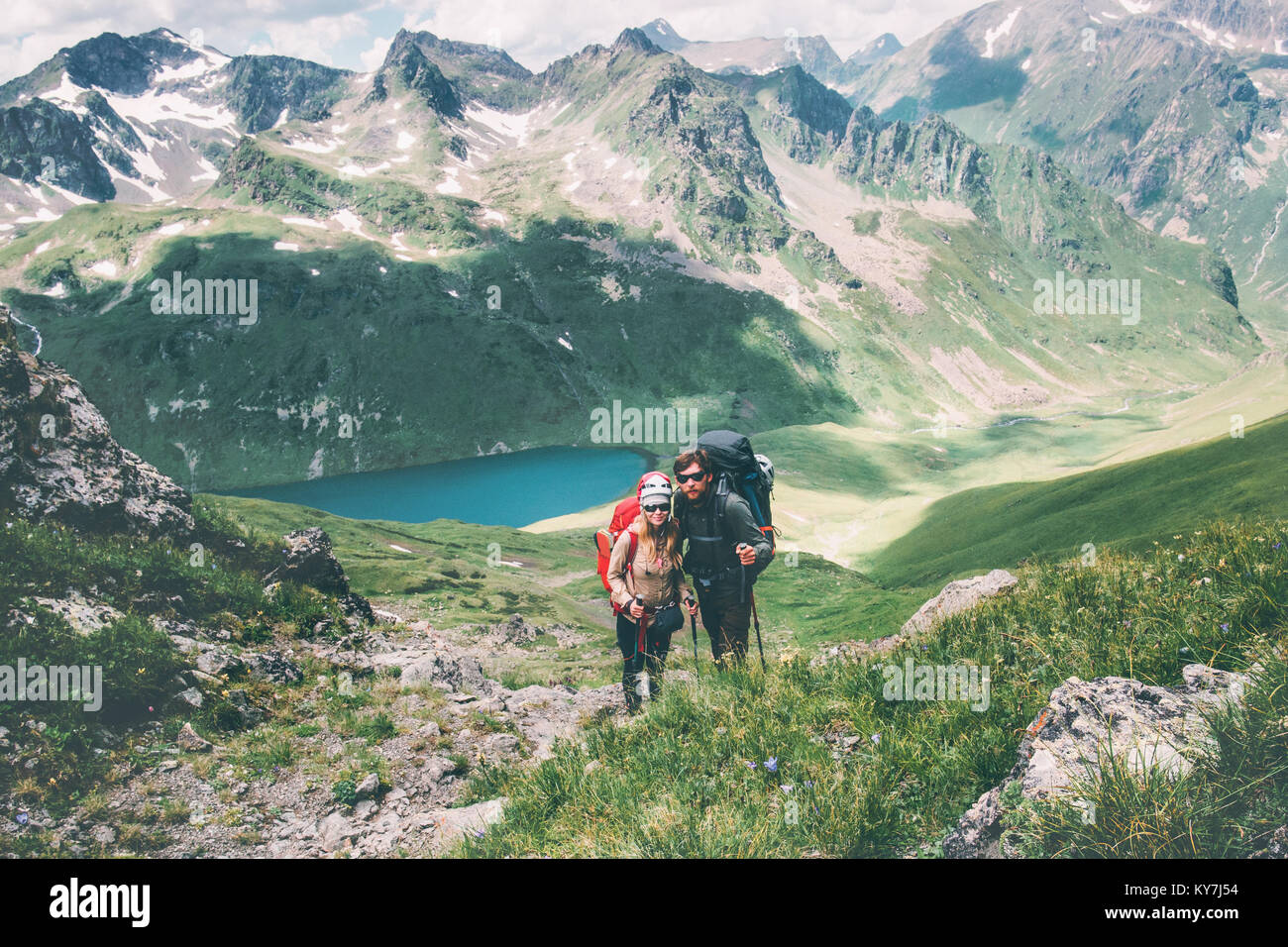 Couple travelers Man and Woman climbing in mountains Love and Travel happy emotions Lifestyle concept. Young family - Stock Image