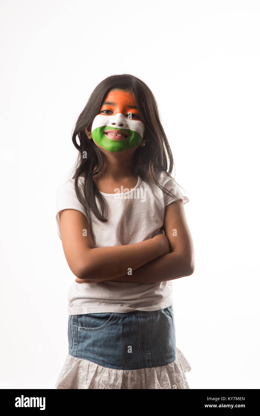 indian girl with paper windmill toy made up of tricolour or indian flag colours. Saluting, looking at camera or - Stock Image