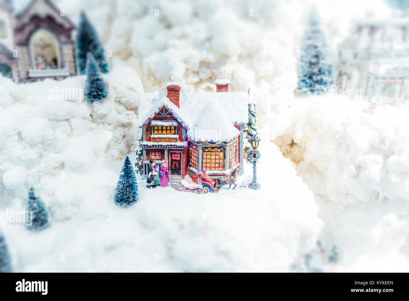 Christmas model landscape with miniature objects in an ornament with snow - Stock Image
