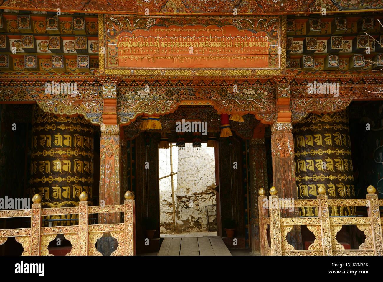 Tango Buddhist monastery and university, entrance with prayer wheels, Bhutan - Stock Image