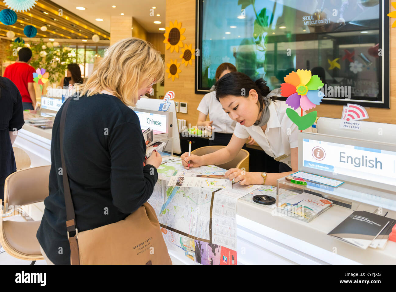 Seoul, South Korea - Tourist at with map in the Tourist Office, Seoul, South Korea - Stock Image