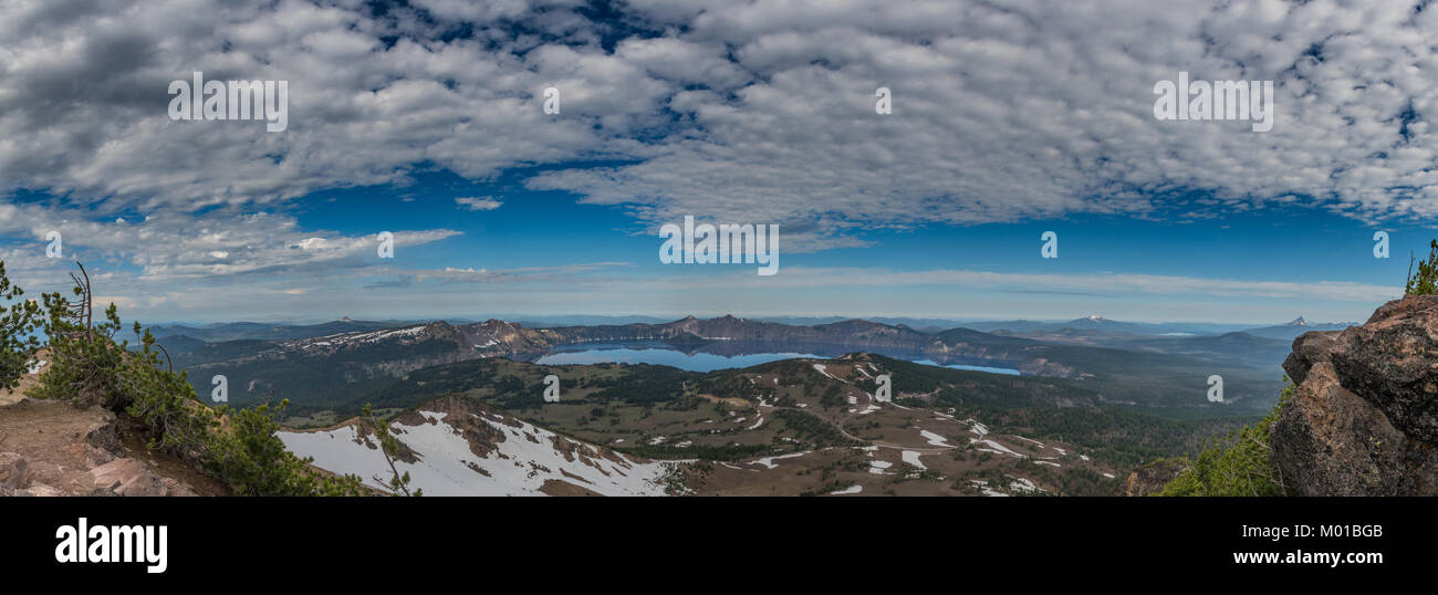 Clouds Over Crater Lake Panorama from Mount Scott Overlook - Stock Image