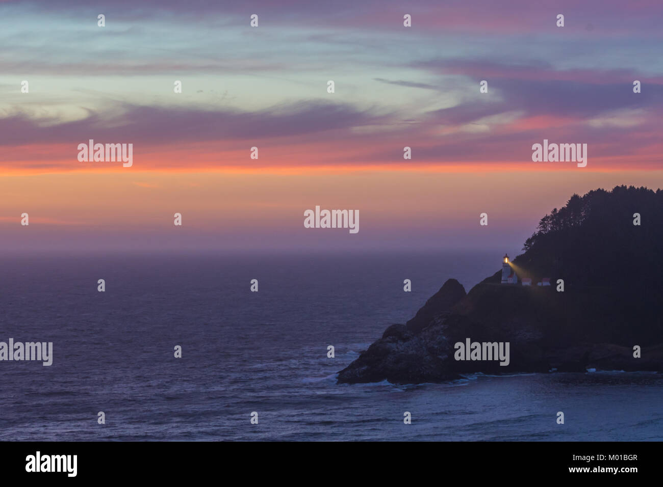 Clouds Reflect Sunset Over Heceta Head Lighthouse - Stock Image