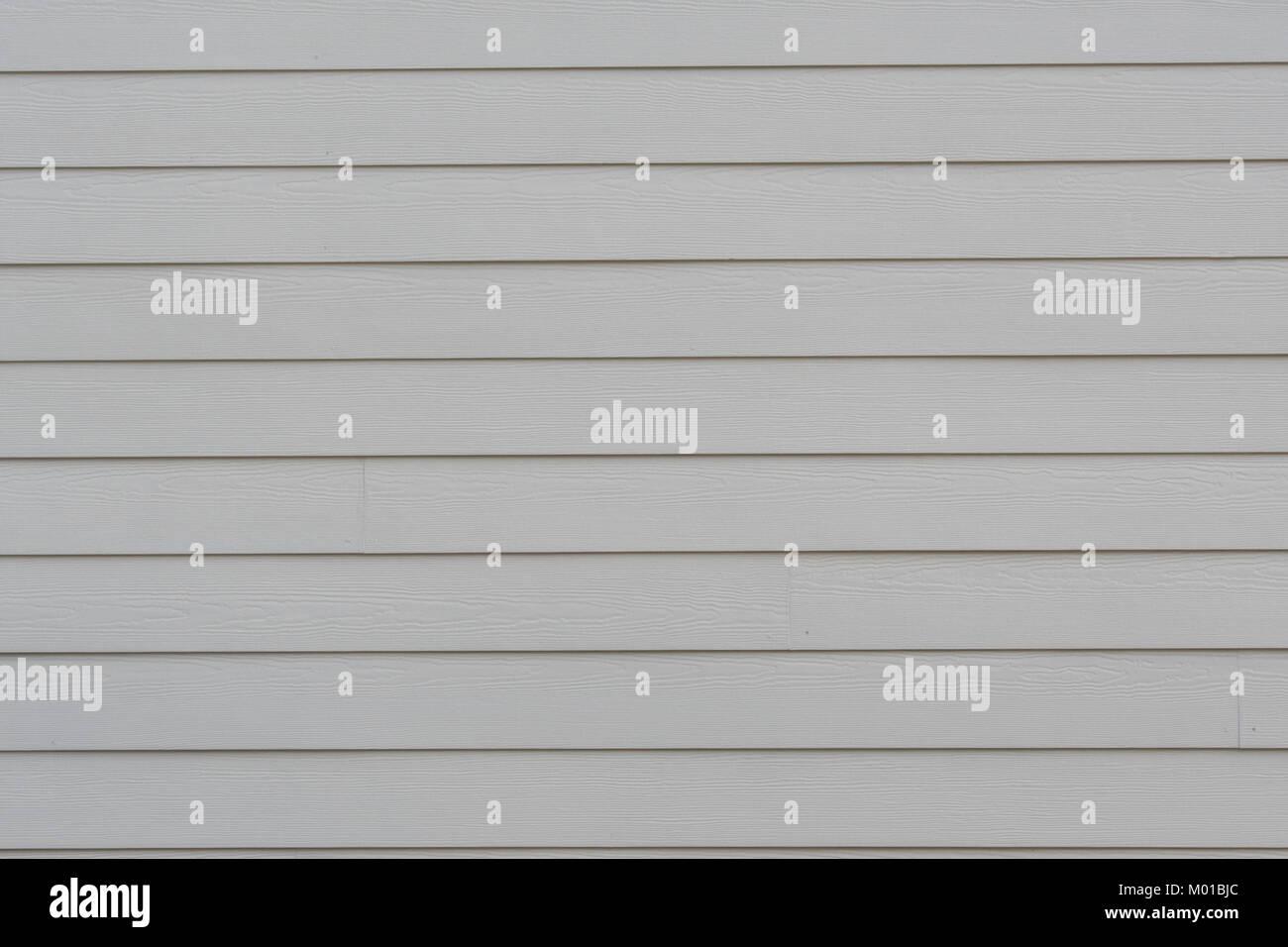 Cream Siding of House wide background image - Stock Image