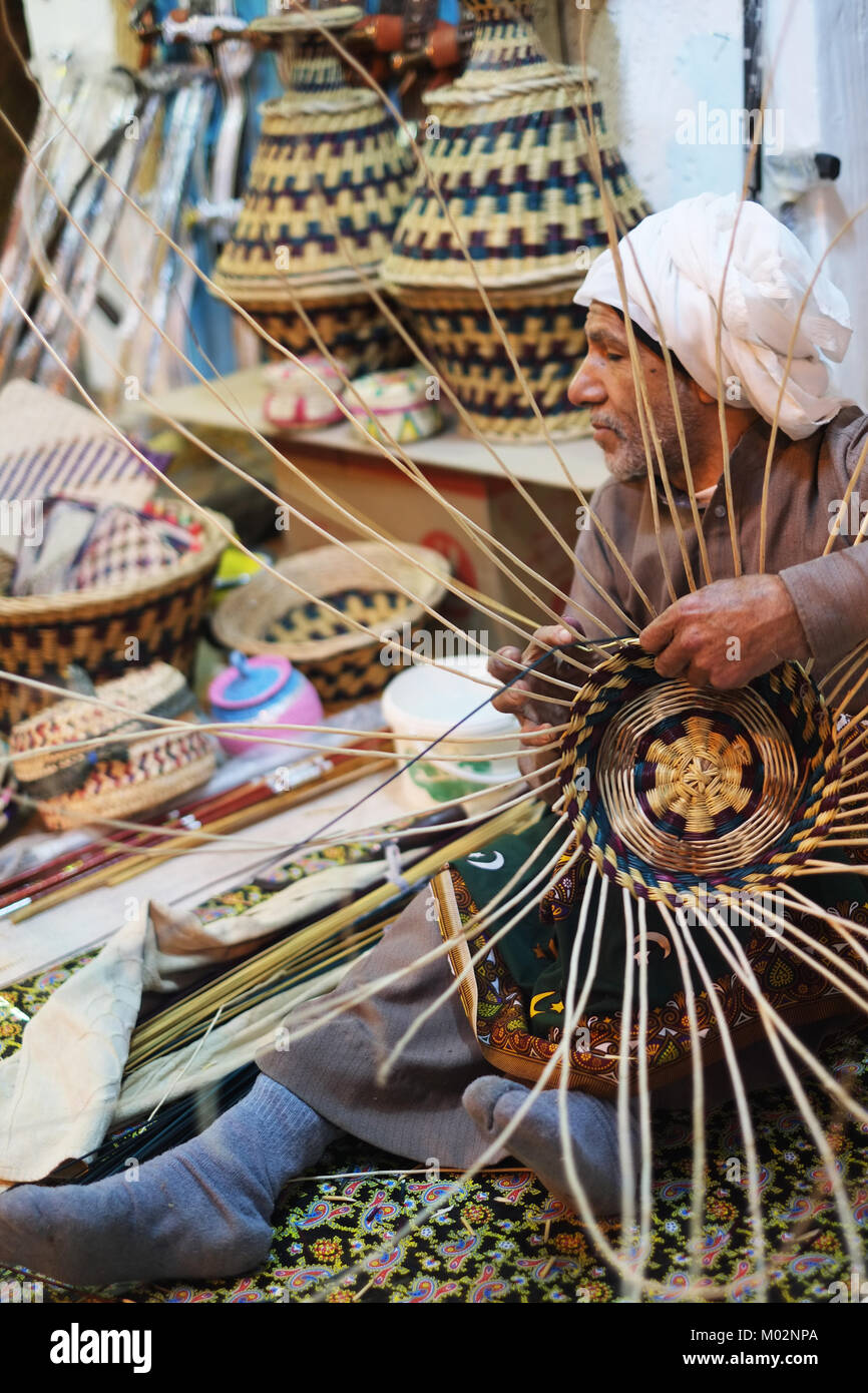An old Saudi Man makes baskets in Janadreyah Festival site in Riyadh - Stock Image