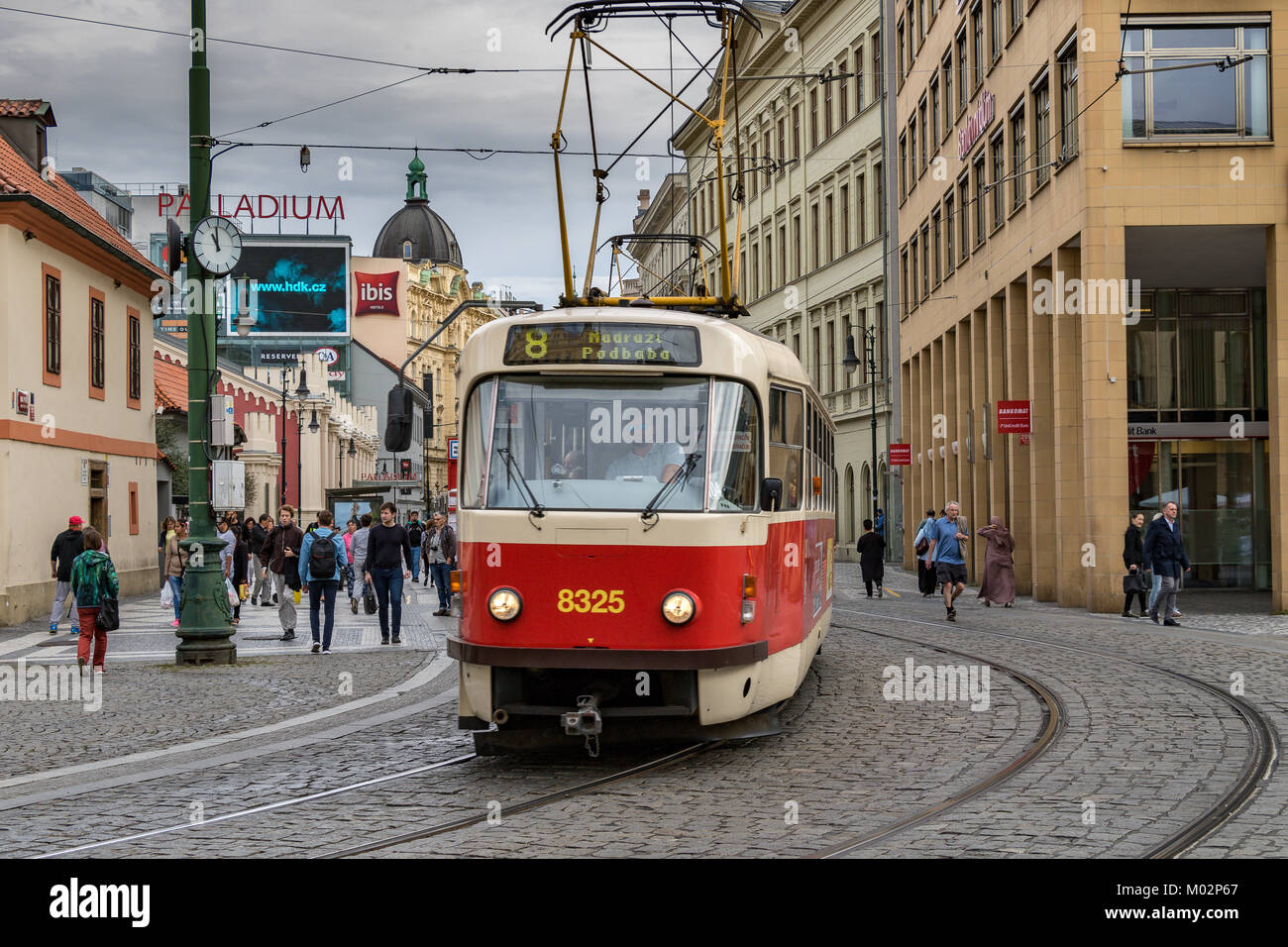 A Tatra T3R.P Tram makes it's way through the cobbled streets of Prague Old Town - Stock Image