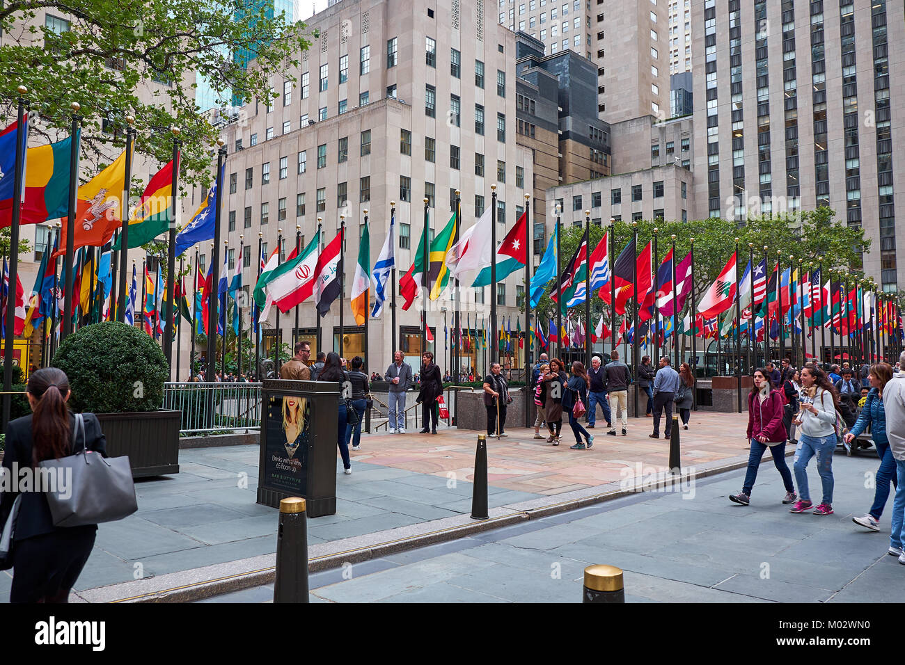 NEW YORK CITY - SEPTEMBER 29, 2016: Many people walking on the pedestrian are around Rockefeller Plaza with all - Stock Image