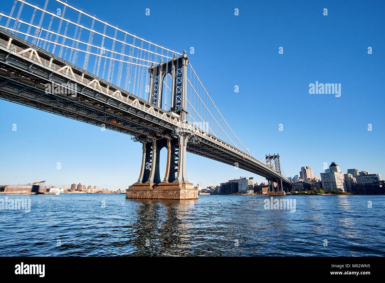 Manhattan Bridge crossing East River to Brooklyn in New York City - Stock Image