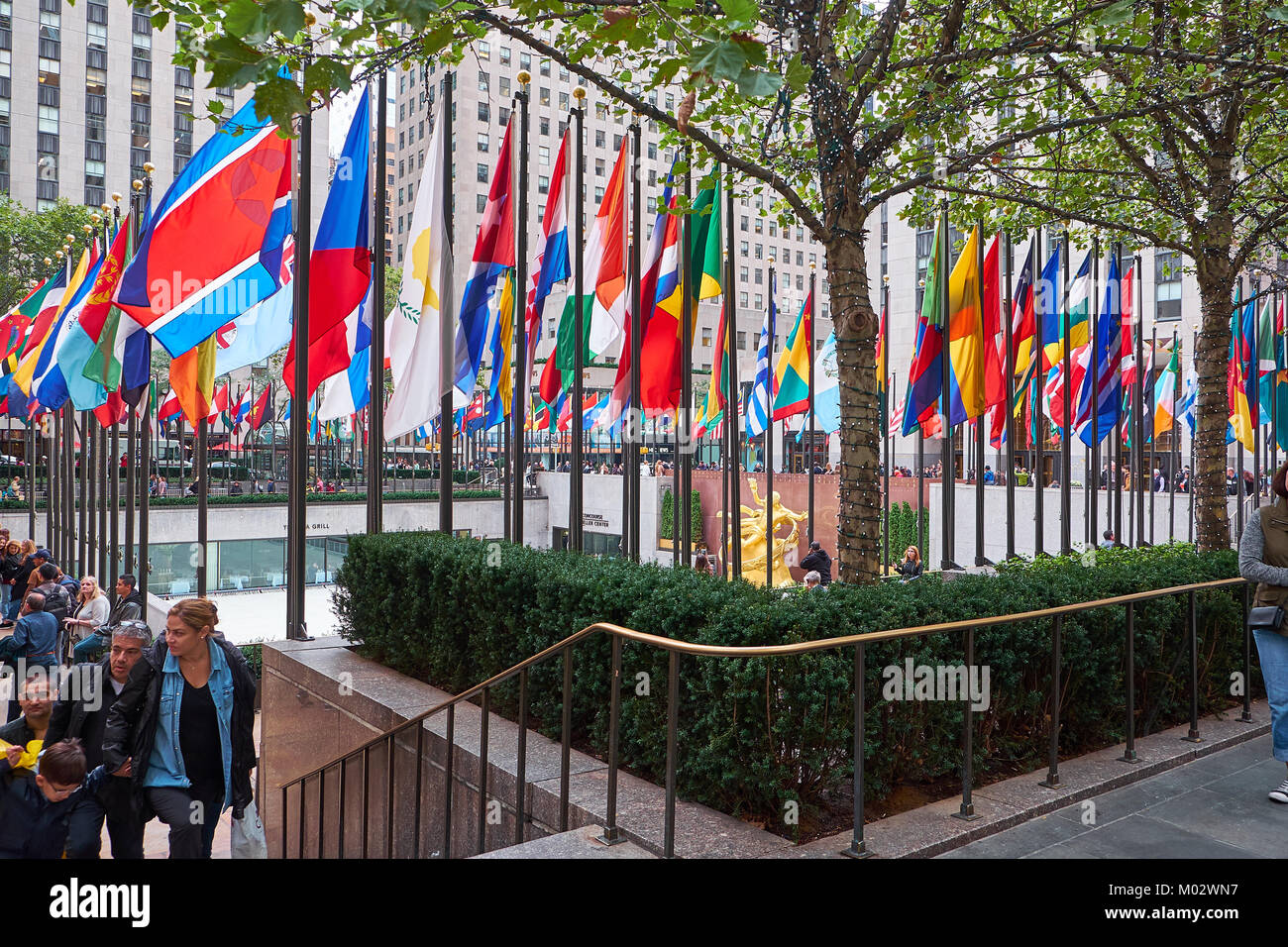 NEW YORK CITY - SEPTEMBER 29, 2016: People walking by the Rockefeller Center Plaza where the famous ice rink is - Stock Image