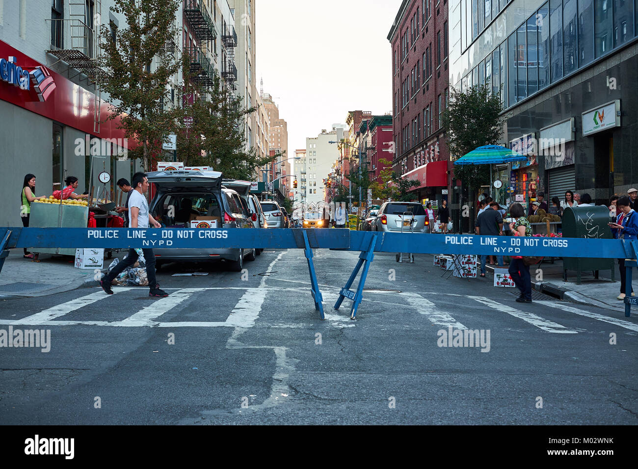 NEW YORK CITY - SEPTEMBER 24, 2016: Police line at the Hester street and Bowery Street cross, with people crossing - Stock Image