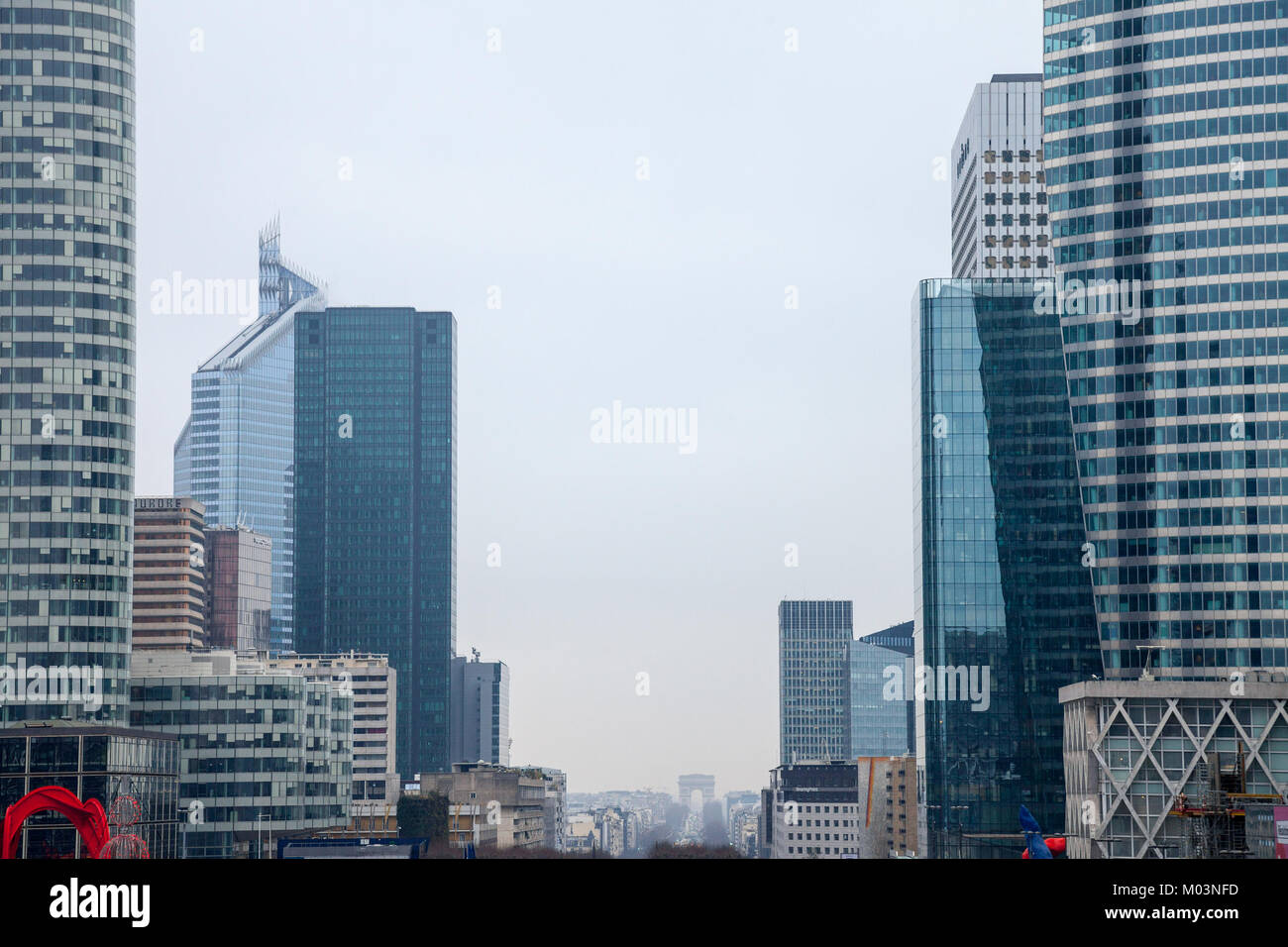 PARIS, FRANCE - DECEMBER 20, 2017: La Defense district skyline with Champs Elysees and Arc de Triomphe in the background. - Stock Image