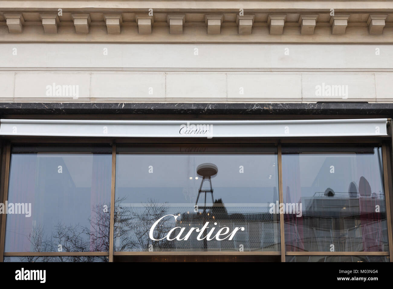 PARIS, FRANCE - DECEMBER 20, 2017: Cartier logo on their main shop on Champs Elysee avenue. Cartier is a French - Stock Image