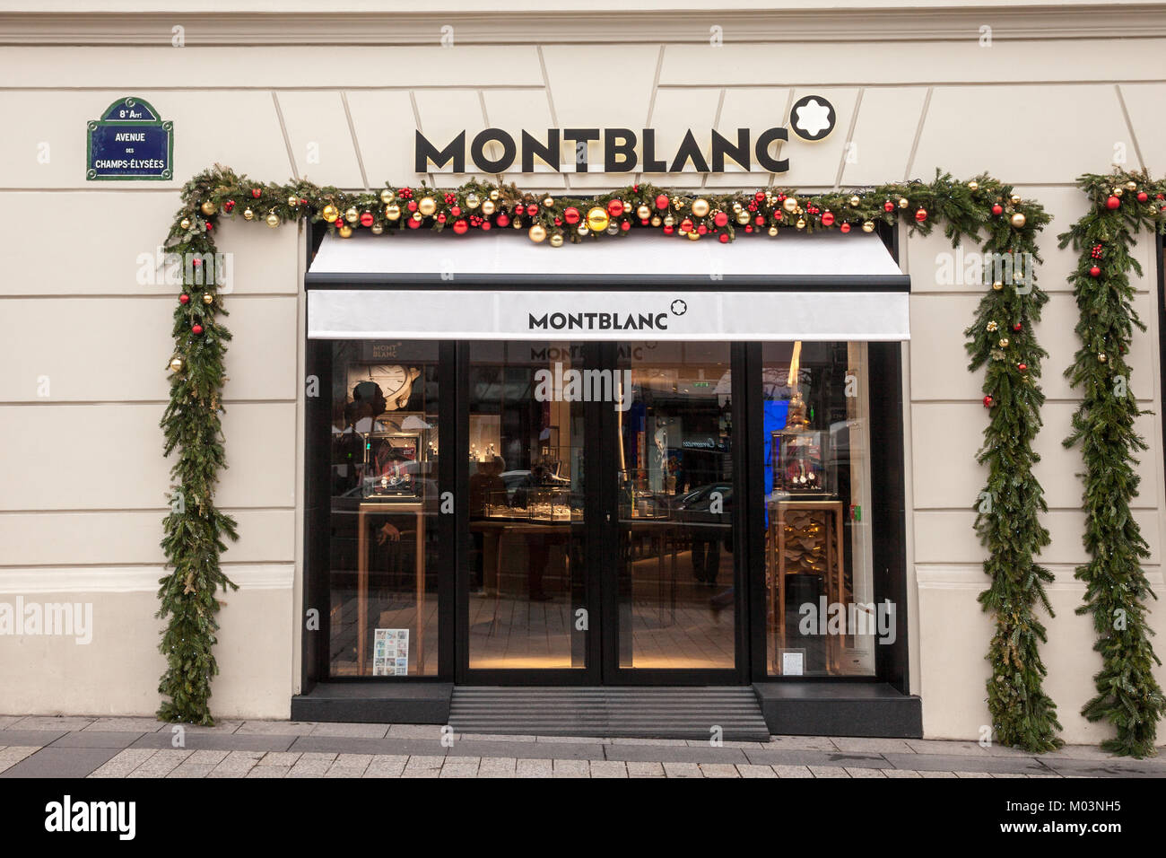 PARIS, FRANCE - DECEMBER 20, 2017: Montblanc logo on their main shop on Champs Elysee avenue. Montblanc is a German - Stock Image