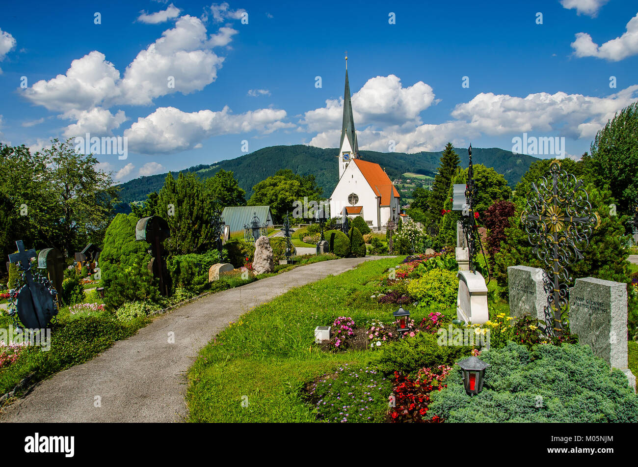 The Bad Wiessee cemetery is set at the Ascension Catholic Church and features the graves of the German composer - Stock Image