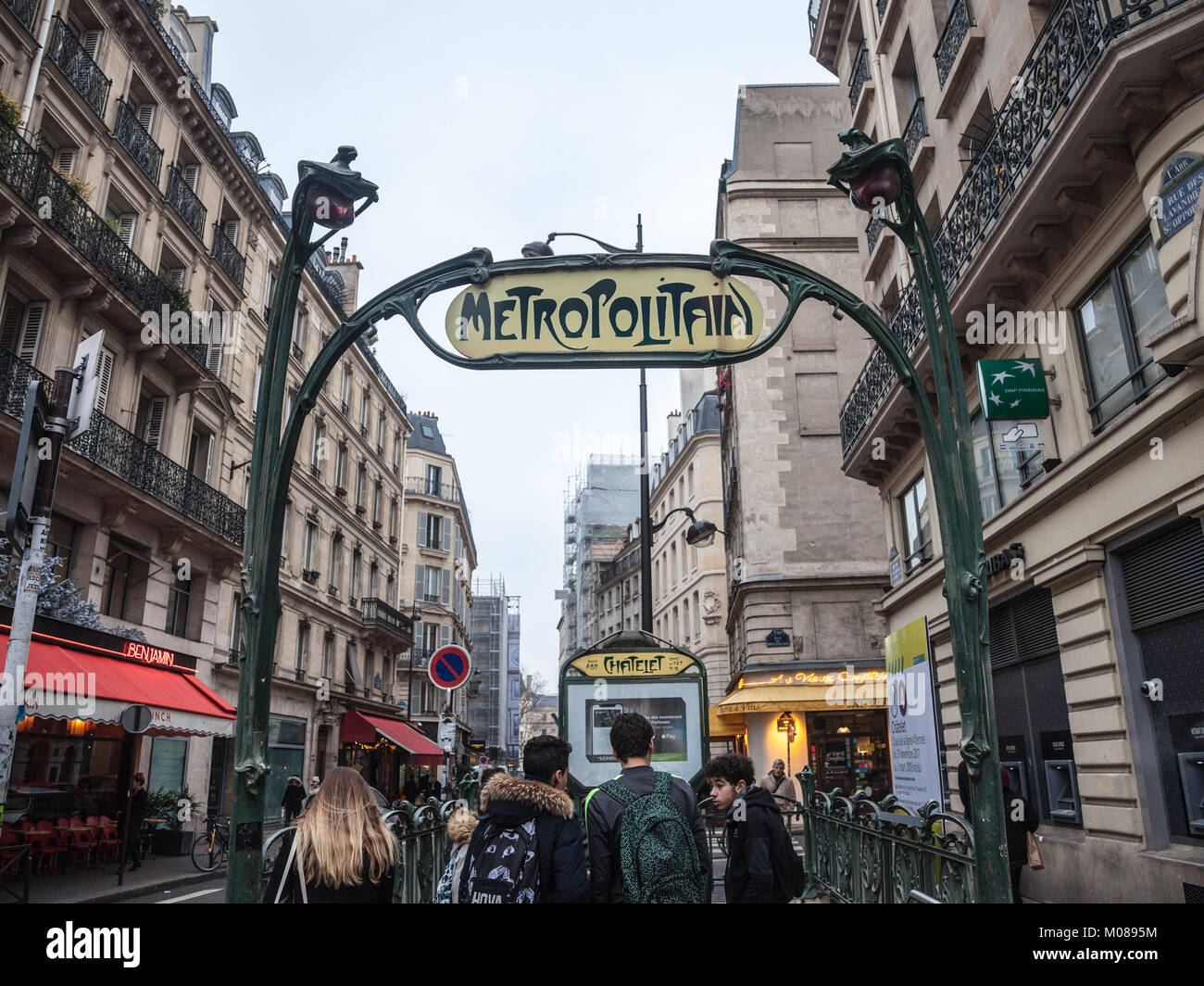 PARIS, FRANCE - DECEMBER 20, 2017: Paris Metro Station in Chatelet with a typical art deco Metro sign designed by - Stock Image