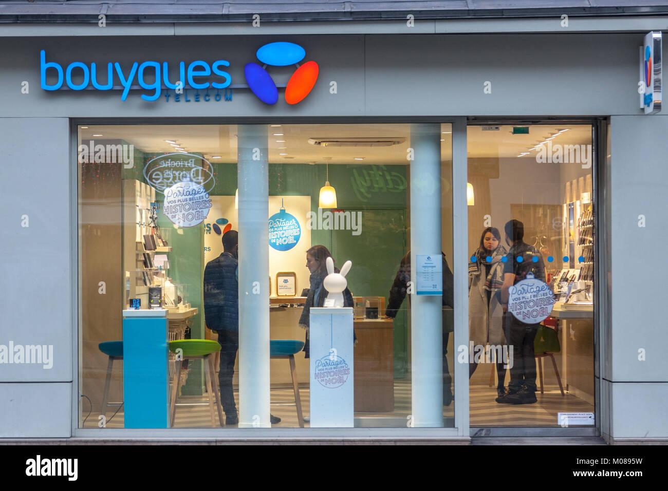 PARIS, FRANCE - DECEMBER 20, 2017: Bouygues Telecom logo on their main shop on Rue de Rivoli avenue. Bouygues Telecom - Stock Image
