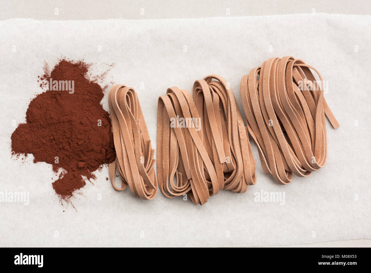 raw Cocoa tagliatelle (noodles) view from above - Stock Image