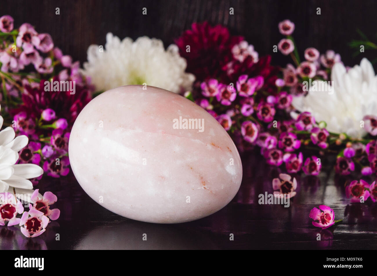 Pink Stone Egg with Mixed Flowers - Stock Image