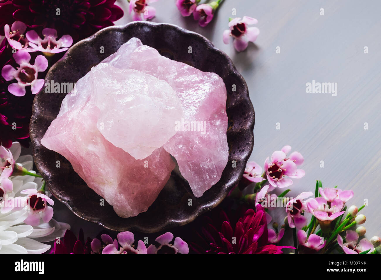 Rough Rose Quartz with Mixed Flowers - Stock Image