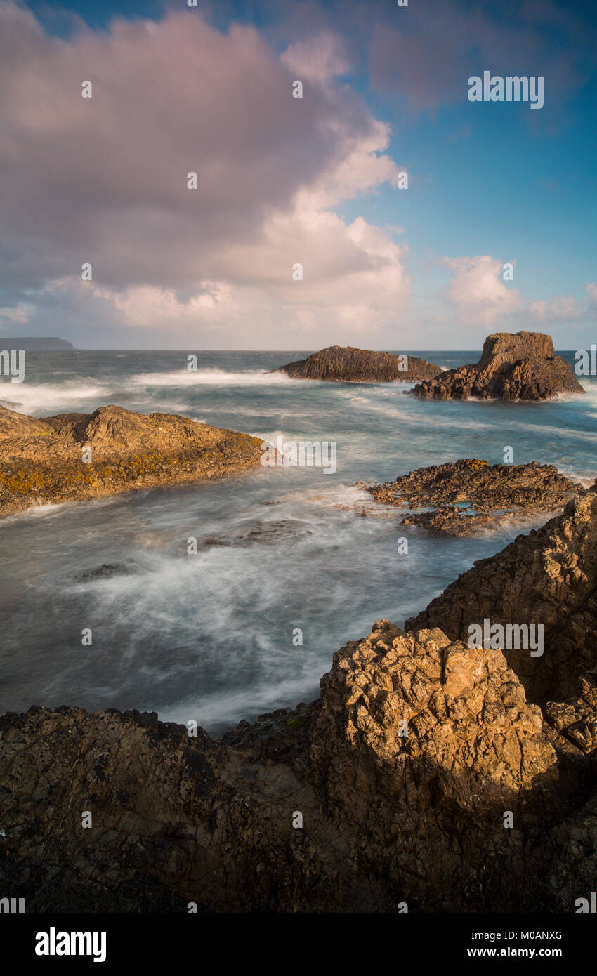 View of the scenic Causeway Coast at Ballintoy Harbour in County Antrim, Northern Ireland - Stock Image