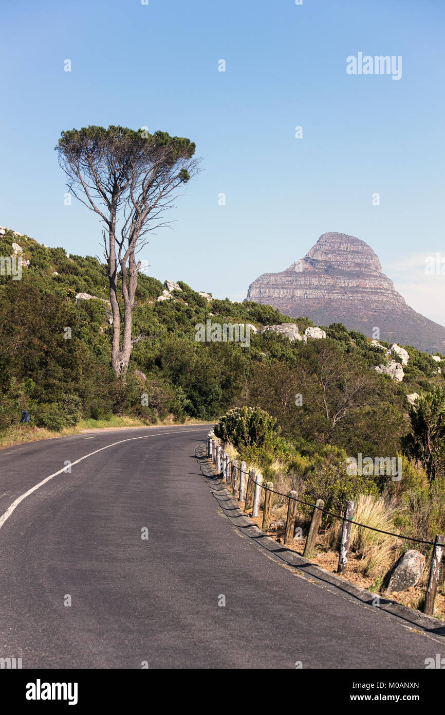 Distant view of Lion's Head from the road beneath Table Mountain in Cape Town, South Africa - Stock Image
