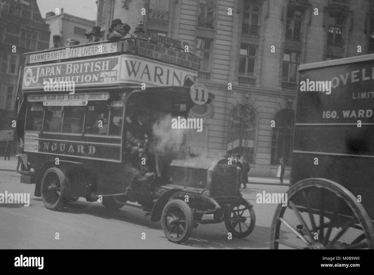 Omnibus on London Thoroughfare carries Advertisements for Japanese British Exhibition - Stock Image