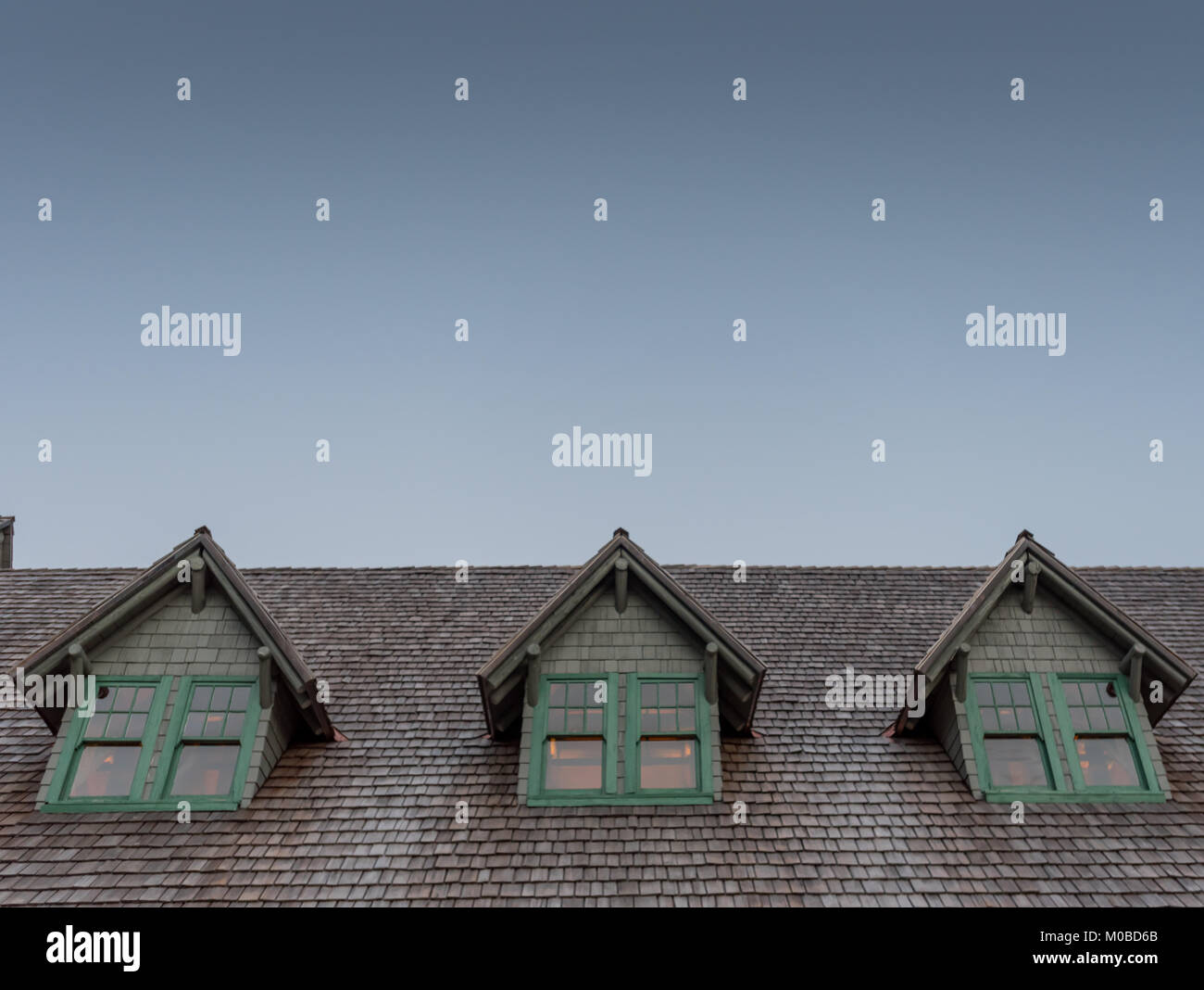 Dormers in Log Cabin Roof with blue sky above for copy space - Stock Image