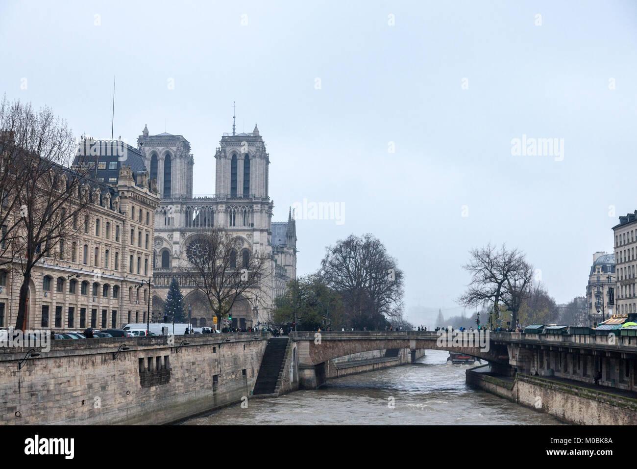 PARIS, FRANCE - DECEMBER 20, 2017:  Notre Dame de Paris Cathedral taken from the Seine river with the Double bridge - Stock Image