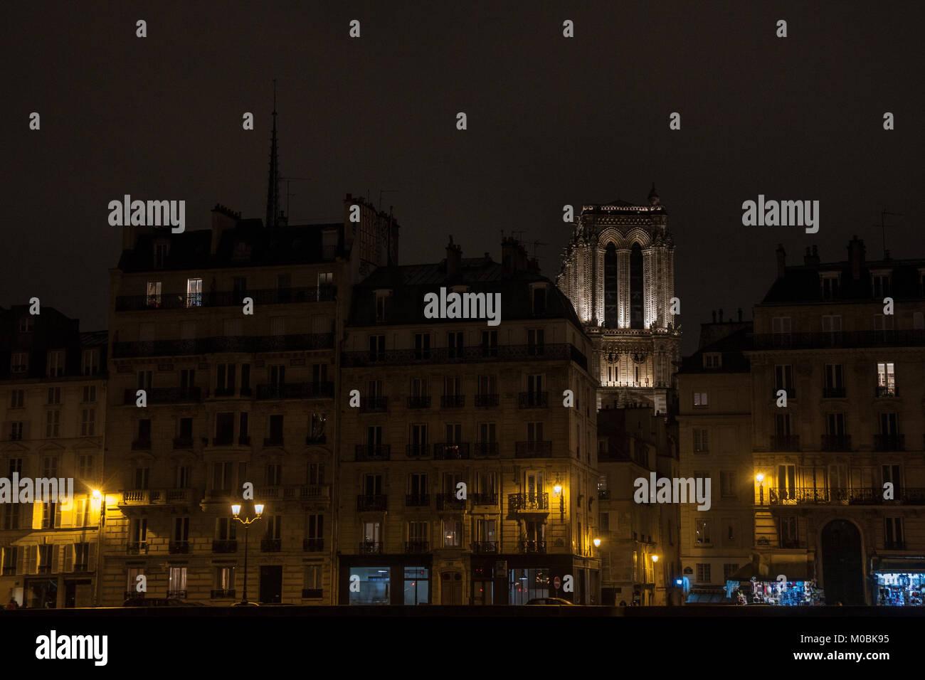 Notre Dame de Paris cathedral surrounded by medieval residential buildings typical from Ile de la Cite in Paris, - Stock Image