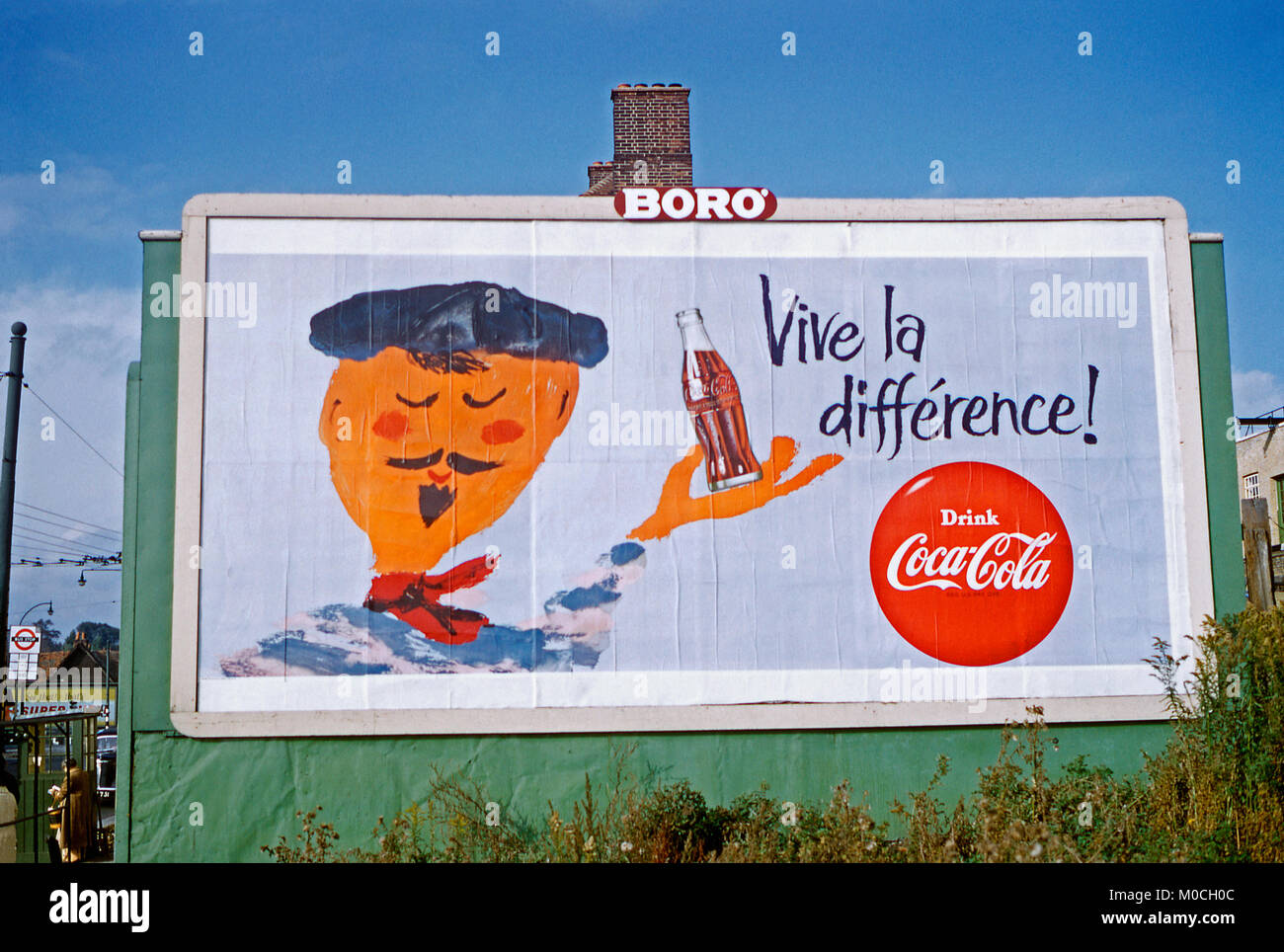 1959 poster on an advertising hoarding or billboard in Edgware, North London with the French saying 'Vive la - Stock Image