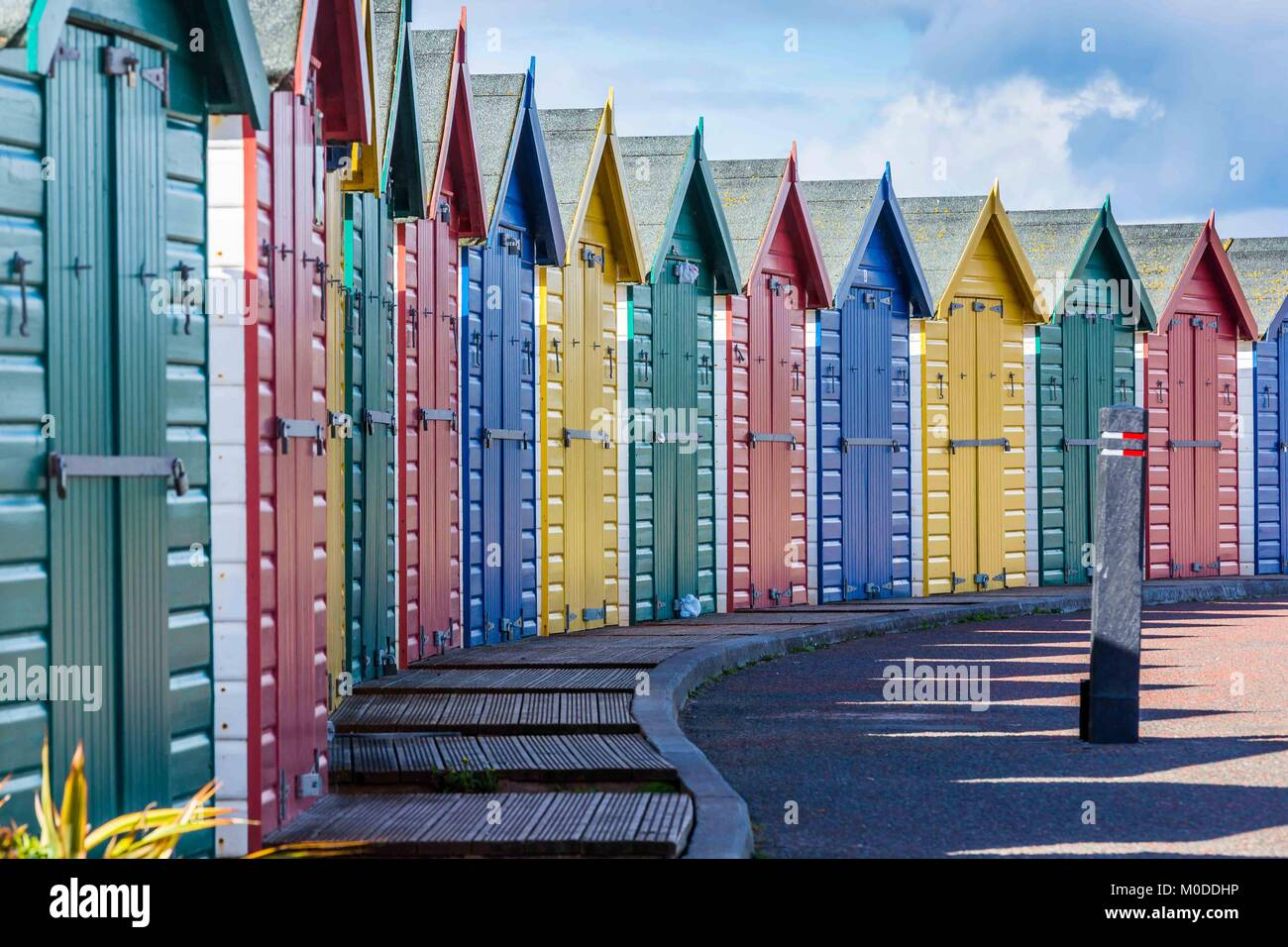 A row of Beach Huts or changing rooms at Dawlish Warren, Devon, UK - Stock Image