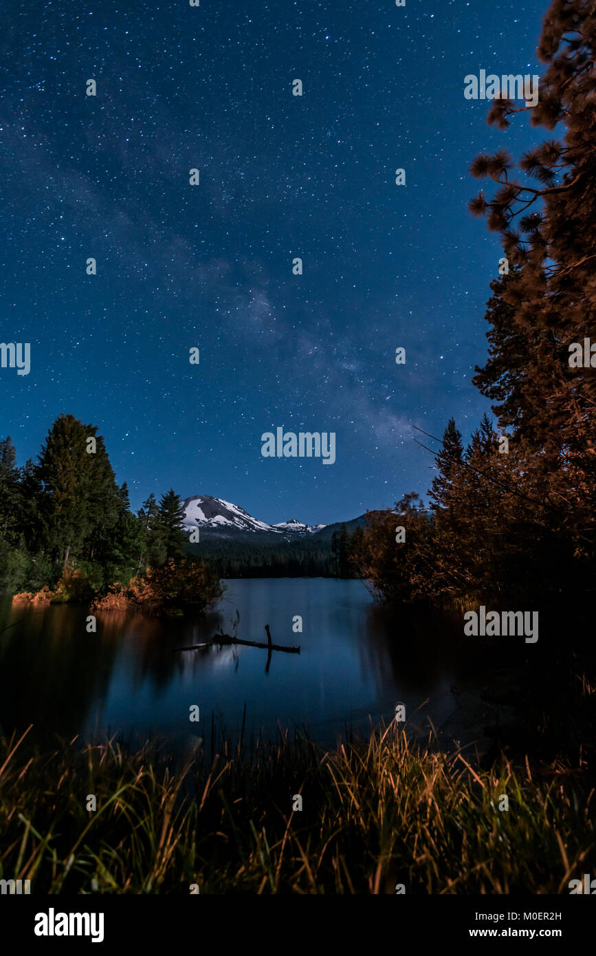 Stars and Milky Way Over Manzanita Lake with Lassen Peak - Stock Image