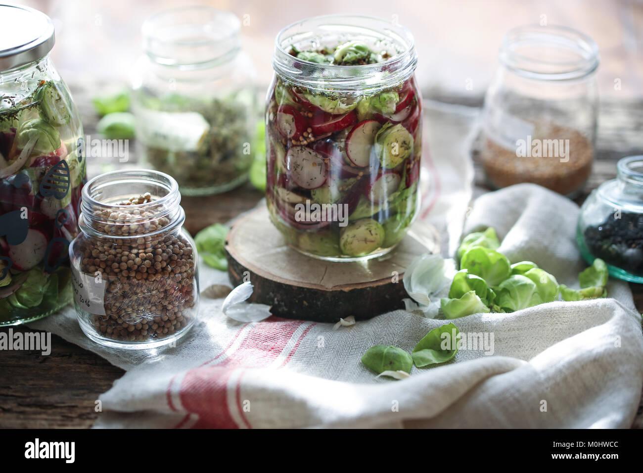 Jar full of homemade fermented veggies. - Stock Image