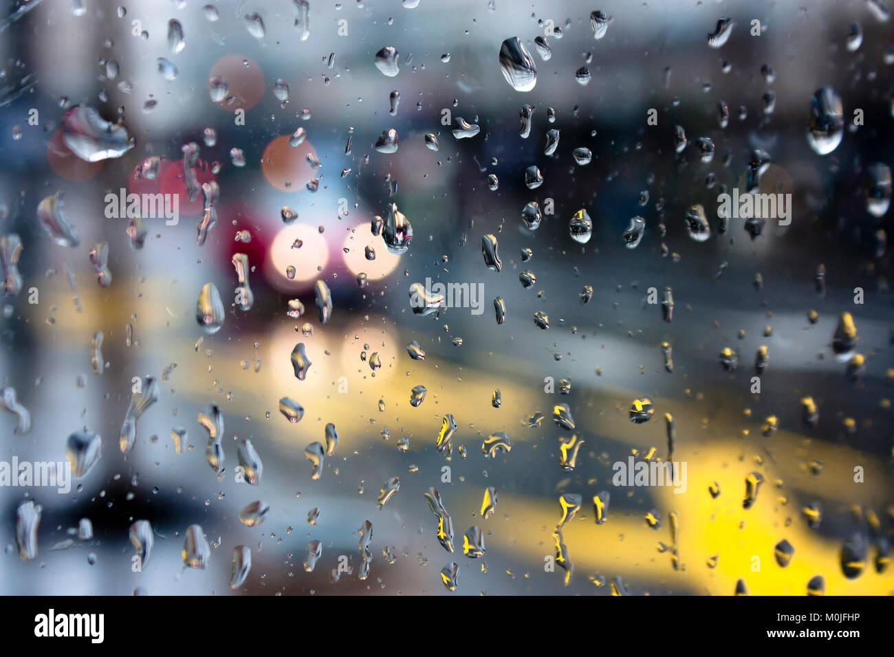 city through rainy window stock photos amp city through