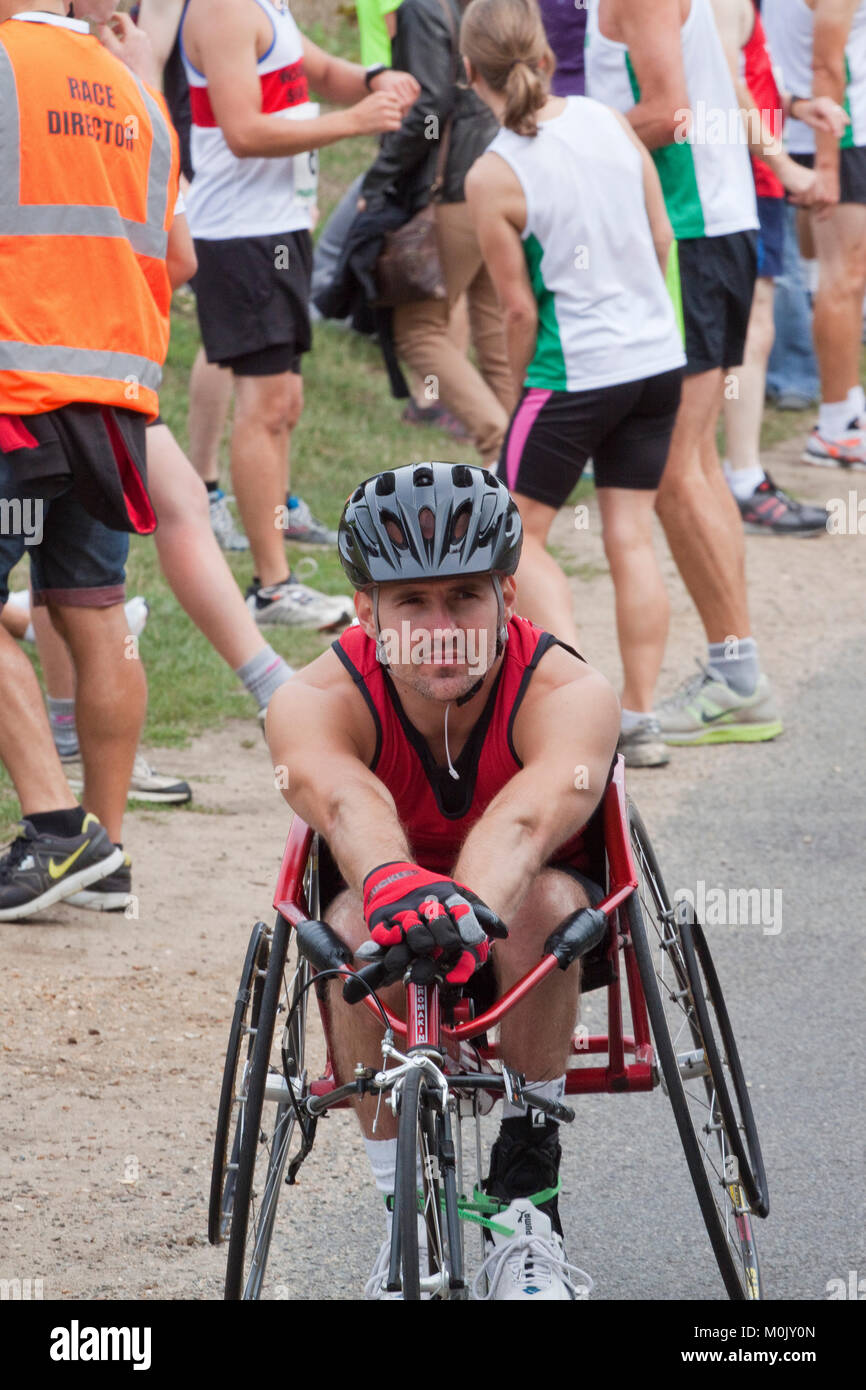 Wheelchair athlete waiting at the start of a road race - Stock Image