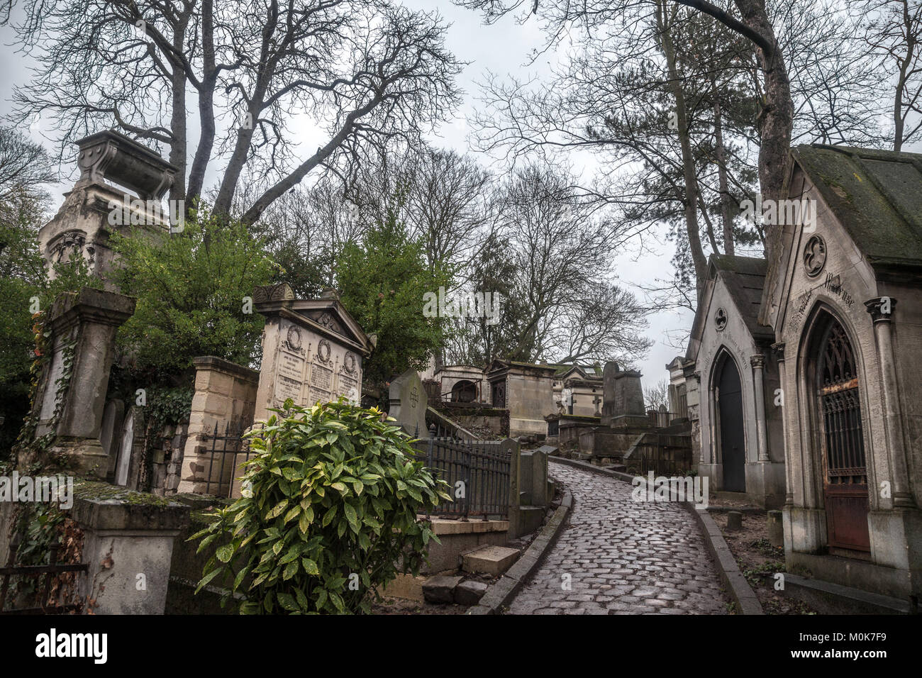 PARIS, FRANCE - DECEMBER 22, 2017: Graves from the 19th century in Pere Lachaise Cemetery in Paris, France, during - Stock Image