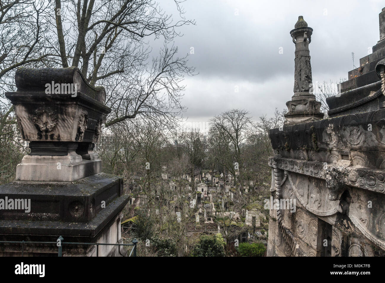 Graves from the 19th century in Pere Lachaise Cemetery in Paris, France, during a cold cloudy winter afternoon. - Stock Image