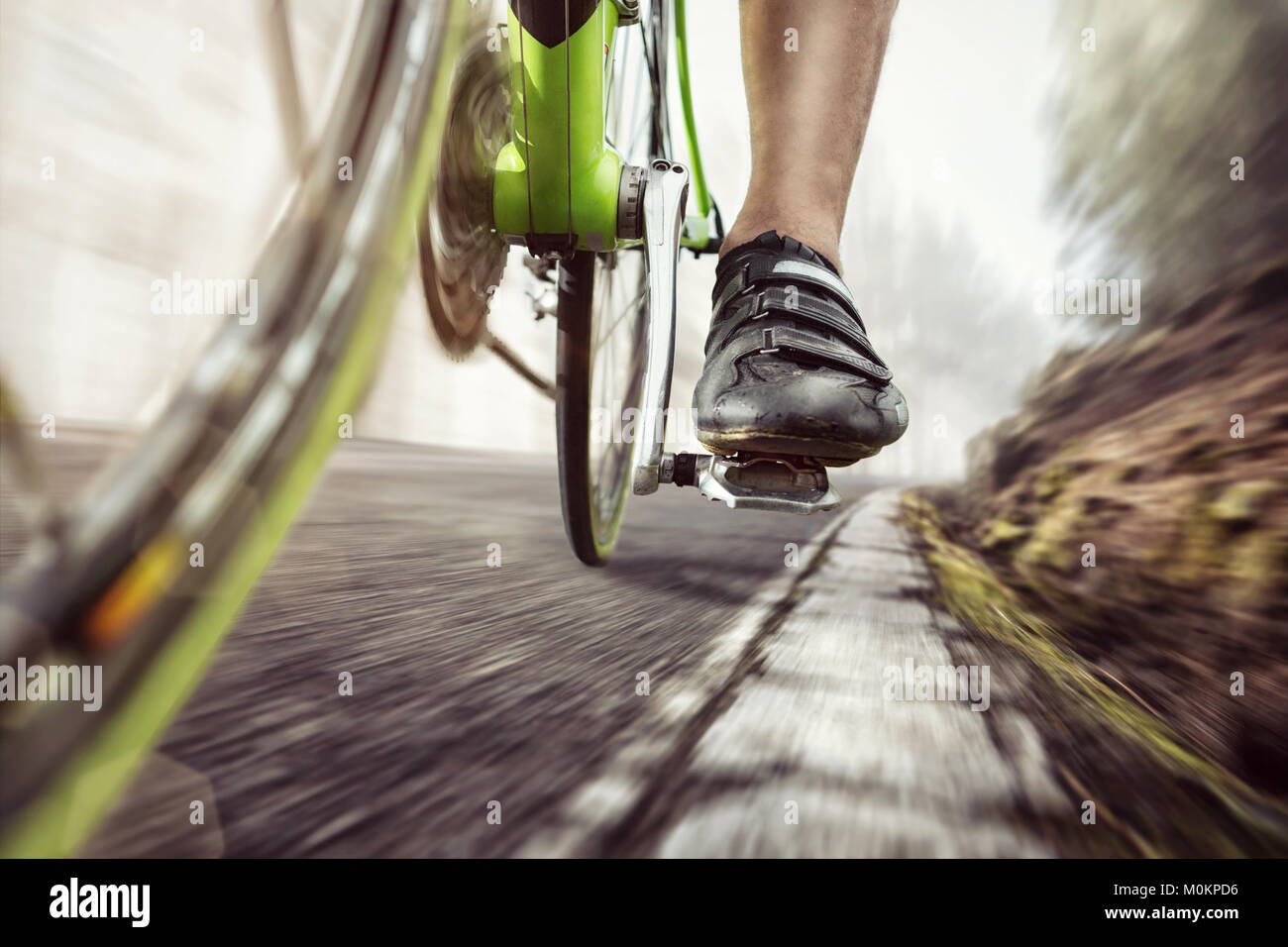 Pedal of a fast moving racing bicycle - Stock Image