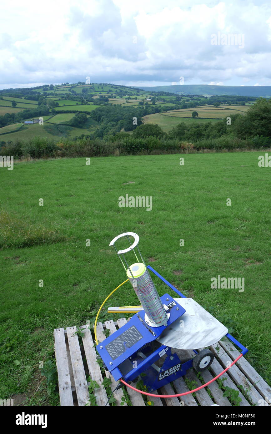 An automatic laser clay pigeon shooting trap - Stock Image
