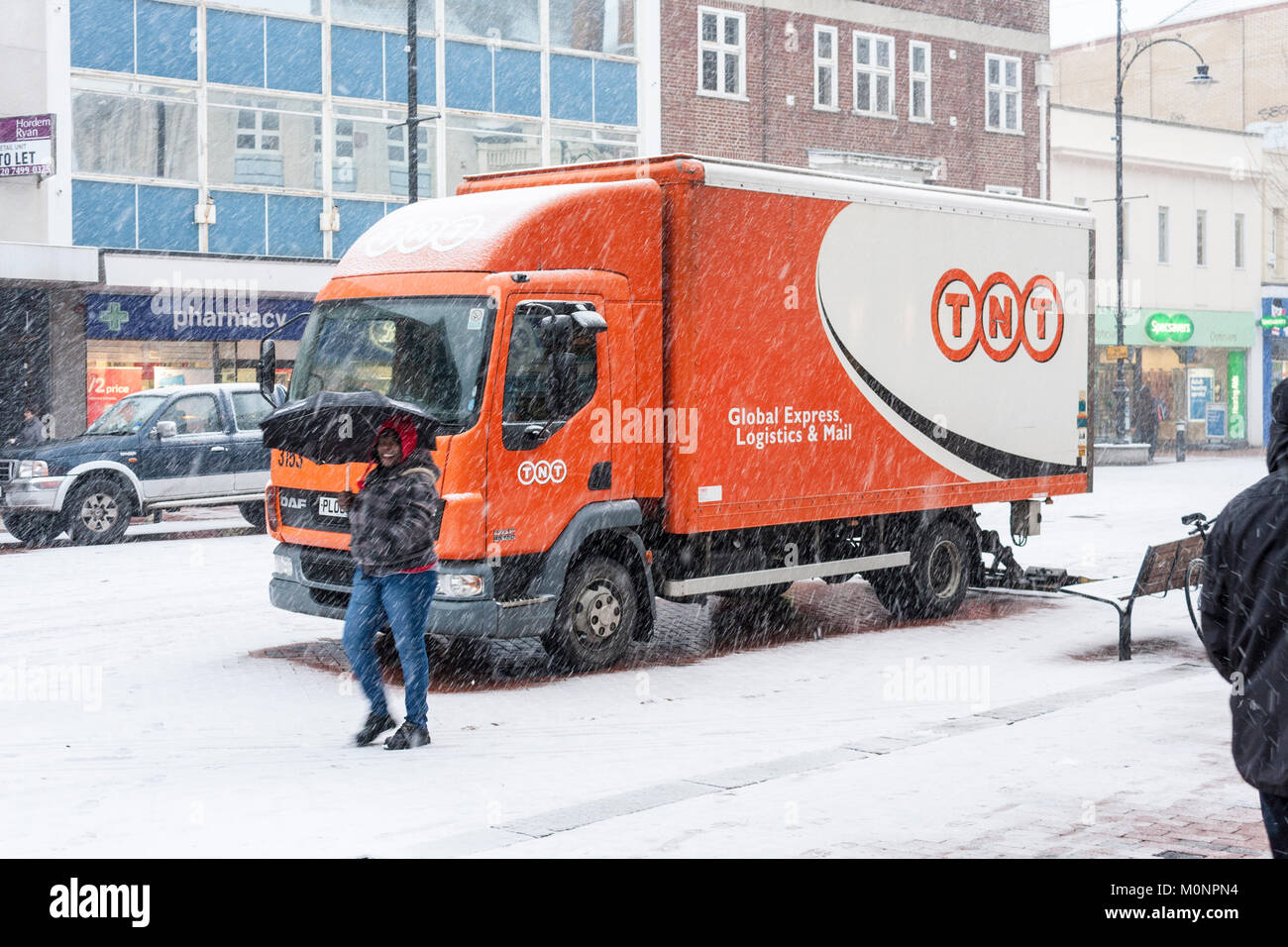 TNT Delivery Lorry delivering goods in town centre in snow blizzard. Reading, Berkshire, England, GB, UK - Stock Image