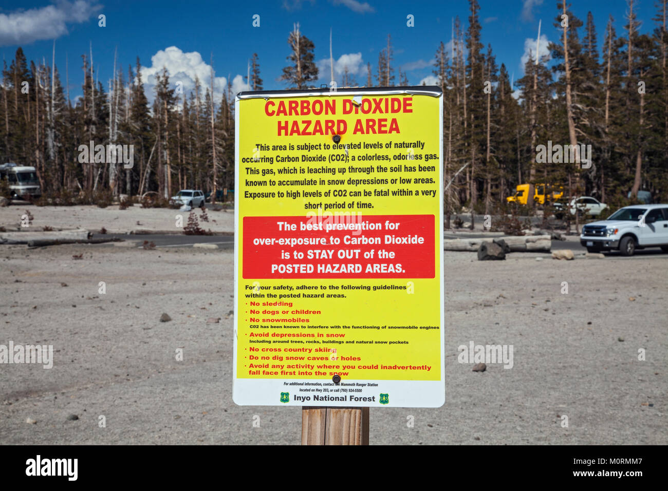 Carbon Dioxide Hazard Area warning sign. Dead trees around Horseshoe Lake. Higher than normal concentrations of - Stock Image