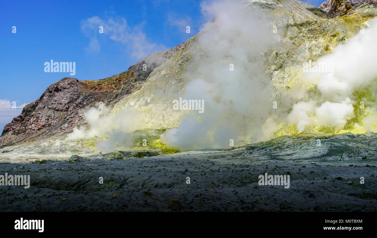 Sunlight catches the sulfurous gas coming from numerous fumeroles. White Island / Whakaarian volcano. Bay of Plenty, - Stock Image