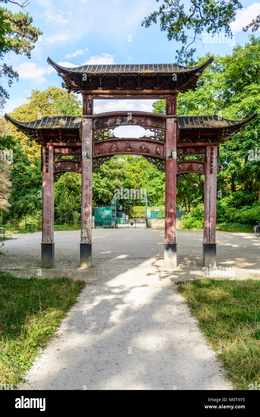 Rear view of the old wooden chinese gateway standing at the main entrance of the garden of tropical agronomy in - Stock Image